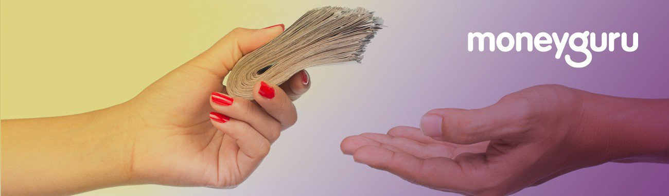 Hands repaying money owed for loan repayments
